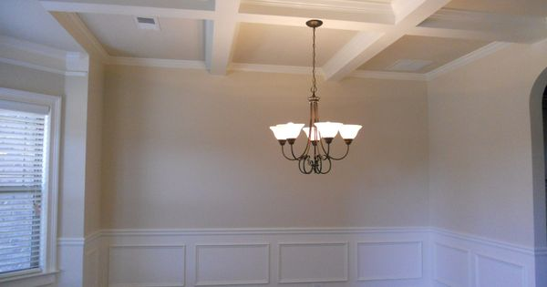 The Dining Room Is Appointed With Coffered Ceilings And