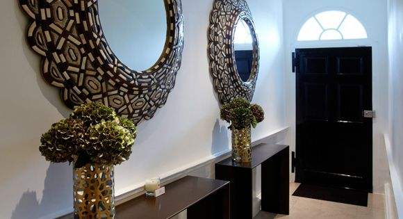 Dramatic pair of mirrors in a long narrow entrance hall for Narrow decorative mirrors