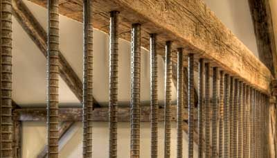 Vertical Rebar Baluster With Wood Beam Rails Deck
