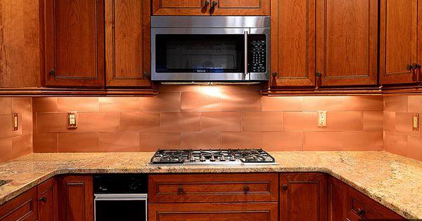 Dark Cabinets With Light Countertops And A Cooper Backsplash Subway Tile Kitchen Backsplash