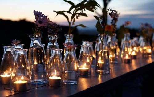 A gorgeous display of summer candlelight & flowers