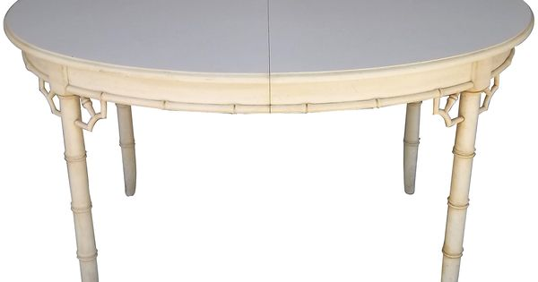 dining table with faux bamboo legs  fretwork corners  and white formica top  includes two leaves