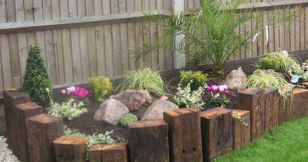 Pallet pieces used as walls for a raised bed great for Flower beds out of pallets