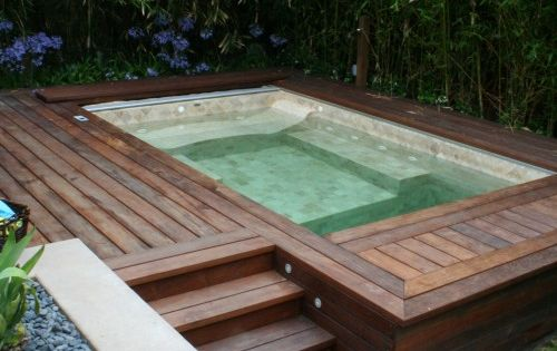 Built in hot tub with wood deck and bamboo landscaped wall for