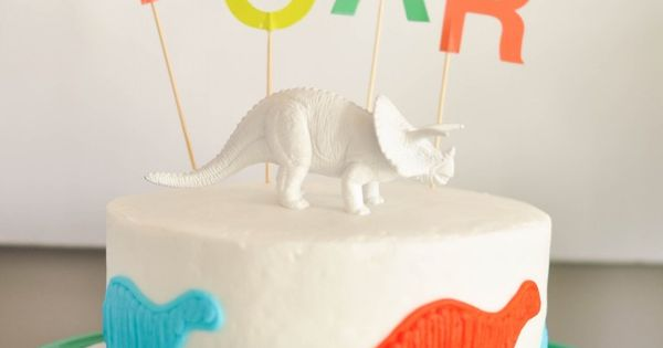 A Store Bought Dinosaur Birthday Cake With Oh Joy For