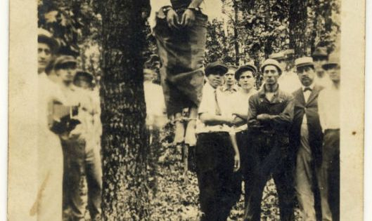 postcard lynchings Lige daniels hangs from the tree in center, texas his neck is bent backwards so that his head makes a grotesque right angle with his body his corpse wears a white shirt and rumpled jeans.
