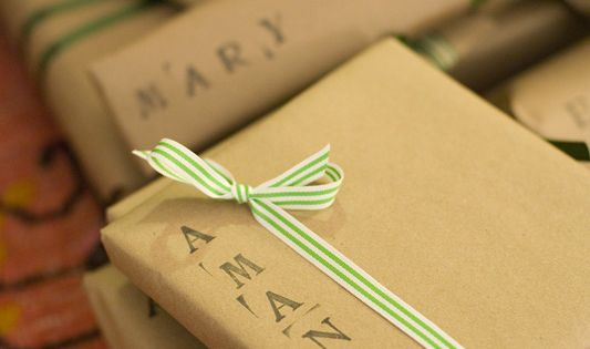 """Name, stamp, sticker, or designs on simple """"brown packages tied up with"""
