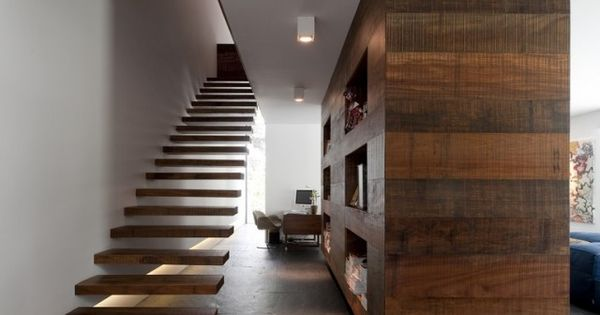 Contemporary floating stairs and wood room divider