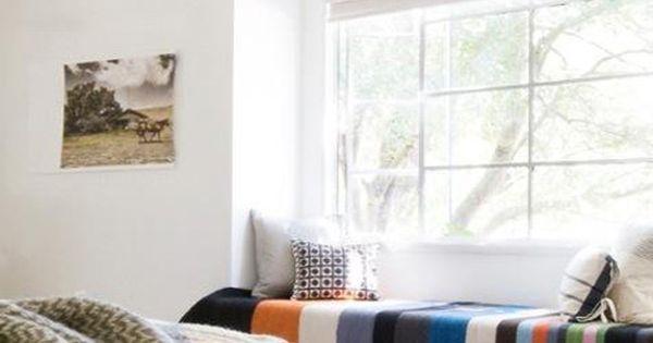 window bench and big fringe blanket