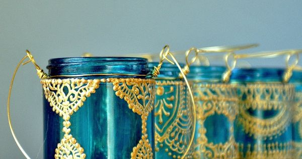 With teal glass and golden detailing beautiful home decor and jars