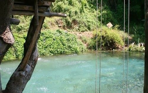 swimming pool made to look like a river. cool idea !!! i