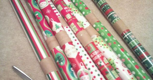 toilet paper rolls to keep the wrapping paper from unraveling! BEST IDEA