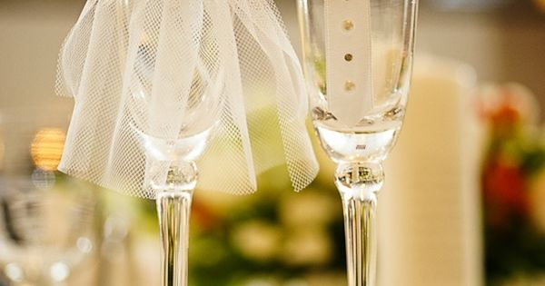 Instead of buying the bride and groom champagne glasses, this could be