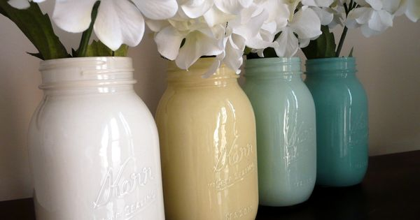 Painted mason jar vases - Pour paint into mason jar, rotate until
