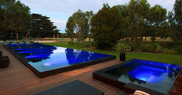 Raised black tile pool and spa with infinity edge on all