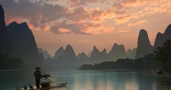 Travel around the world Lijiang river, Guilin, China sunset reflection mountain and