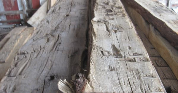 Hand hewn slab siding montana reclaimed lumber co for Log slab siding