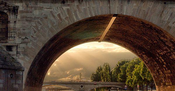 A kiss on a bridge over the River Seine, Paris, France