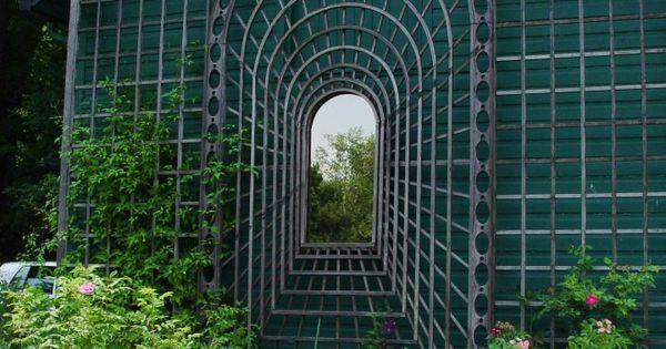 Optical Illusion Trellis With Mirror In Center.