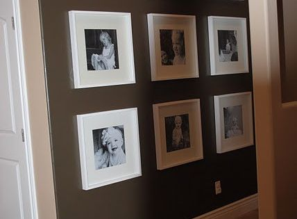 Photo Wall! Love the white frames and black and white photos!