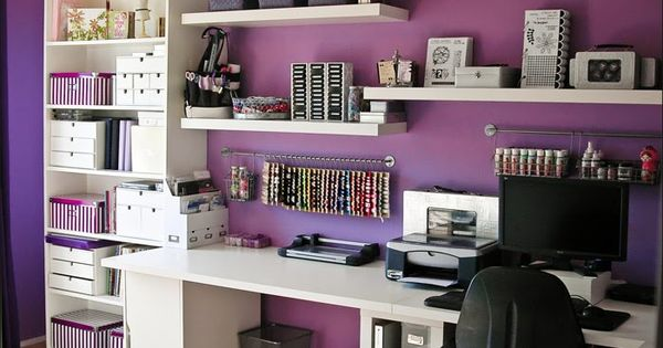 Gorgeous Purple, black and white craft room with white Bookshelves and storage