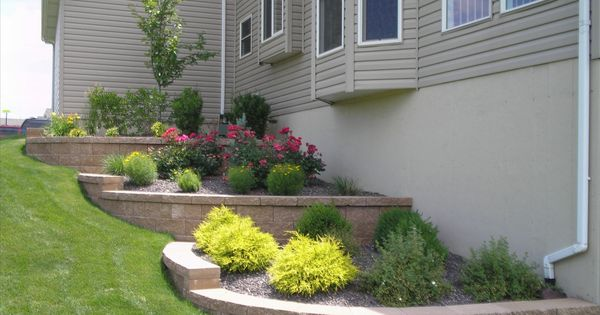 Side hill landscaping front yard stones and little for Landscaping a hill with rocks