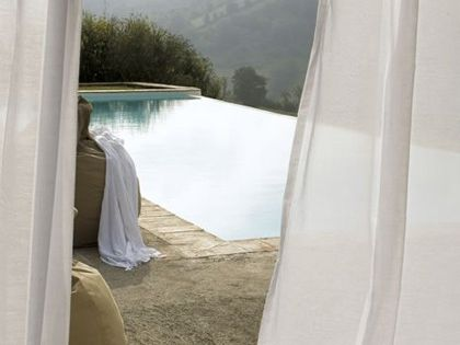 Infinity pool, white curtains, incredible view