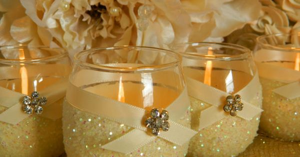 Yellow glitter centerpieces with candle and ribbon