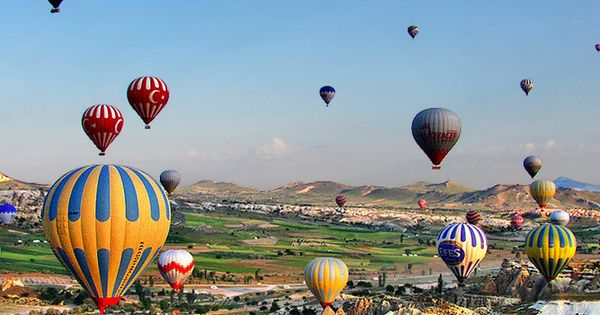 Many Beautiful Balloons In The Sky : ... balloons intent on ferrying as many tourists as possible ov