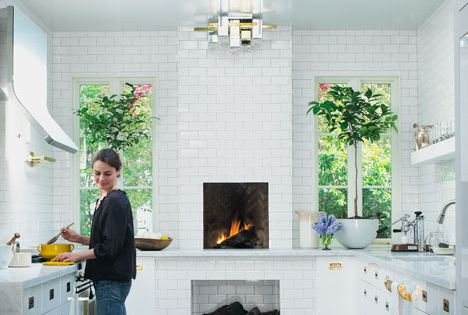 floor to ceiling subway tile, kitchen fireplace, skylight, brass hardware