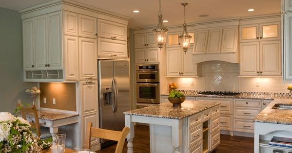 This country kitchen with black/dark granite counter tops im love'n white cabinets