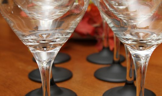 What a great idea for parties! chalkboard paint + wine glasses