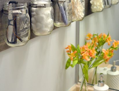 This mason jar organizer is too cute! Perfect for small bathrooms! Great