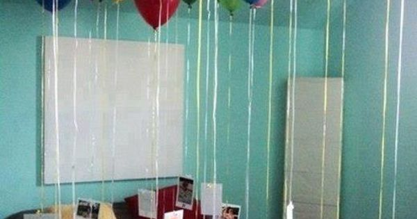Balloons with pictures attached to them.
