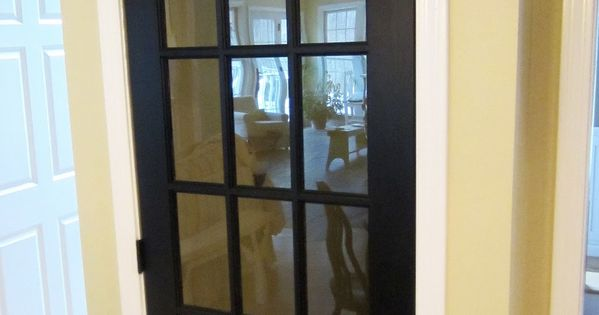 KITCHEN - PANTRY DOOR: such a neat idea replace traditional basement door with a french door via Down to Earth Style. Plus I love the black door since my kitchen is all white.