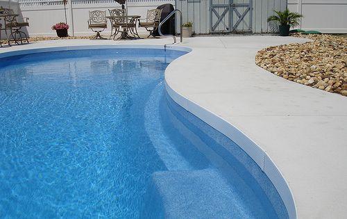 Plain Concrete Patio Around Pool Clean Lines Solid