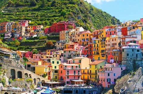 The colorful houses in the harbor of Riomaggiore is a must see