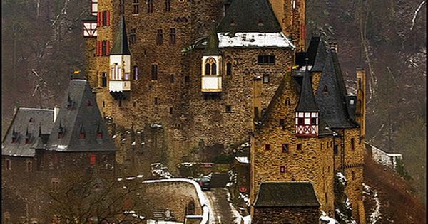 Burg Eltz is a medieval castle nestled in the hills above the