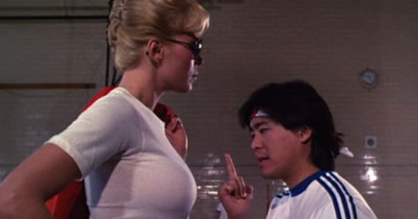 Leslie Easterbrook as the tough female cop in Police