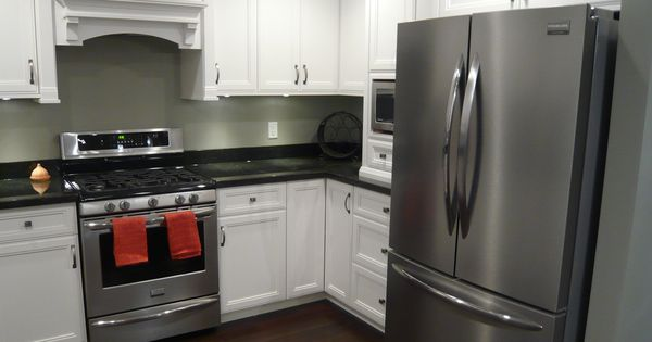 White Cabinets, Black Granite, Dark Hardwood, Stainless