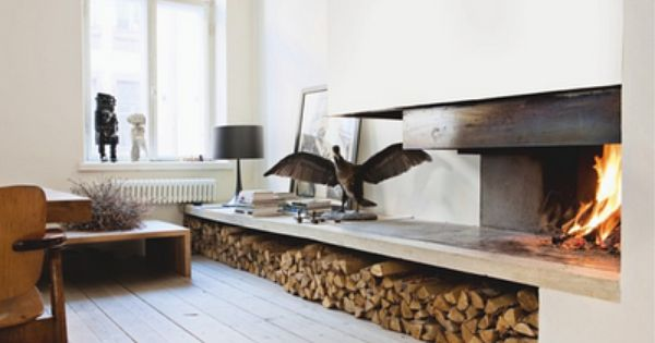Modern fireplace. Awesome log storage!