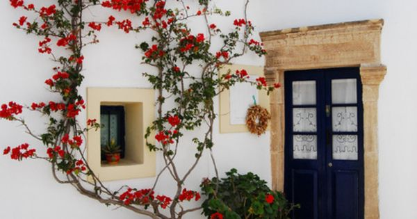 greece maybe? so pretty. white walls and navy blue door with red