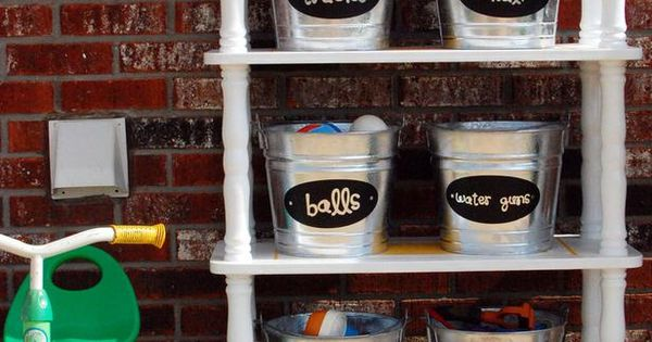 outdoor kid toy organization. Love the buckets! And really love the shelf!