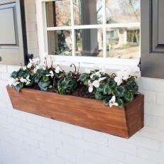Wood Window Flower Box On White Brick Exterior Wall And Black Window Shutters Window Box Flowers Window Planter Boxes Diy Flower Boxes