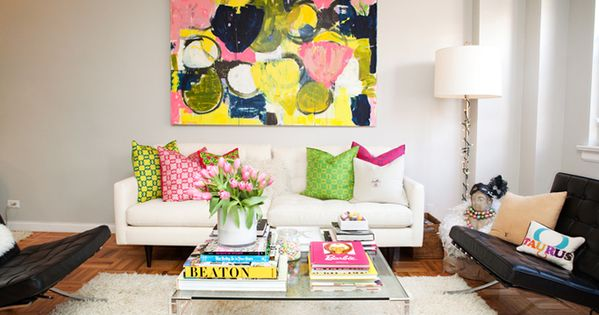 fun white, pink and green living room with large canvas art -