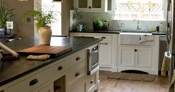 Soapstone: Julia -Cabinets: Custom, inset/flush shaker style with single bead -Sharp microwave