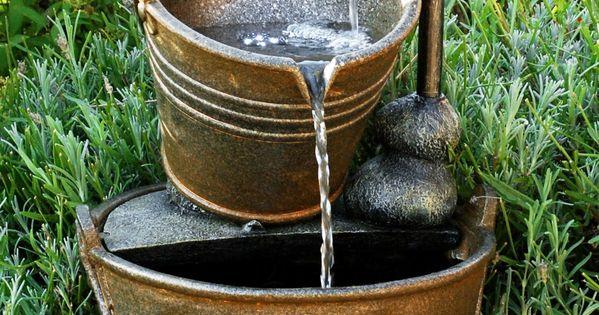 Fuente grifo y calderos con luz arquitectura y for Grifos con luz