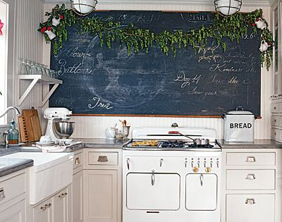 Kitchen. Chalkboard wall. Vintage stove. Industrial lights.