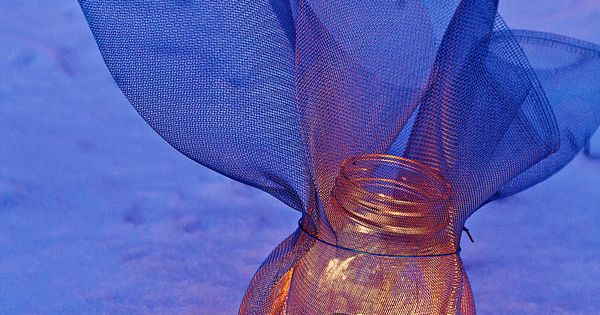 DIY Screen-wrapped mason jar luminary
