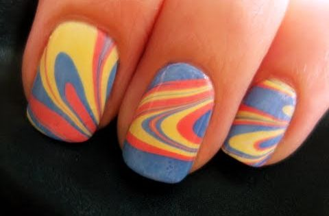This lovely water marble nail design is beautiful and easy to make.